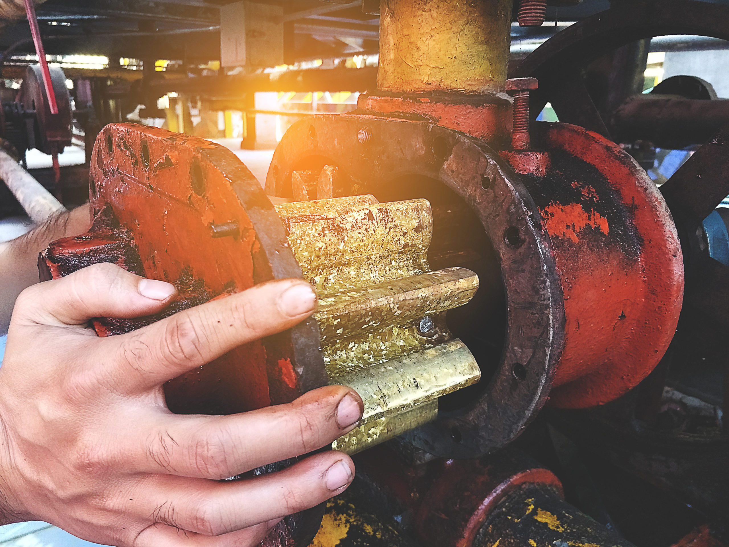 Engineering technicians are repairing the broken liquid pump gears