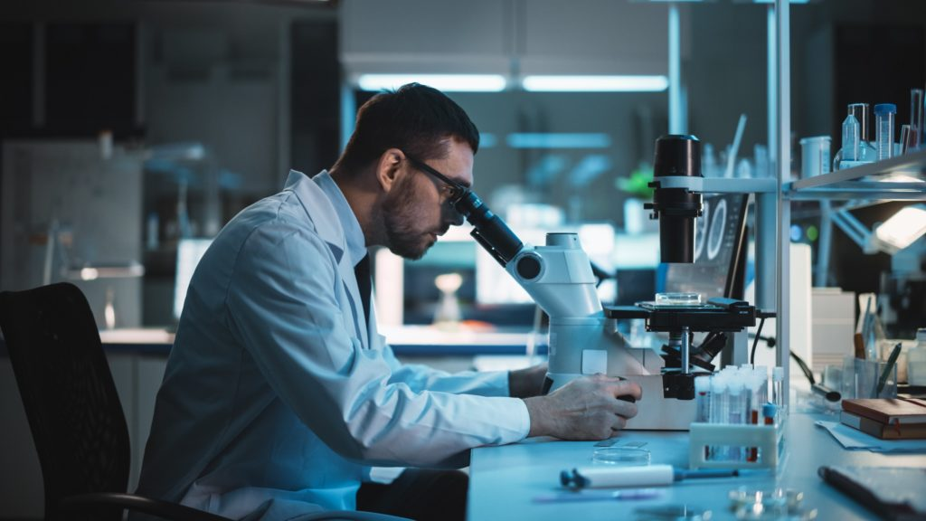 scientific research, Medical Development Laboratory: Caucasian Female Scientist Looking Under Microscope, Analyzes Petri Dish Sample. Specialists Working on Medicine, Biotechnology Research in Advanced Laboratory